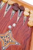 Dices falling on wooden handmade backgammon board Stock Image