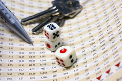 Dices on financial report. With pen and keys for business concept Stock Photo