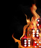 Dices in fire. Over black background Royalty Free Stock Images
