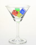 Dices in a glass Stock Photos