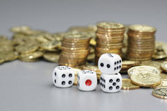 Dices and Gold coins Royalty Free Stock Images