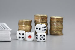 Dices and Gold coins Stock Photos