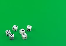 The dices on green. The dices on green background royalty free stock photo