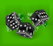 Dices on green Stock Photos
