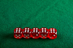 Dices on the green cloth Royalty Free Stock Image