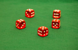 Dices on green cloth Stock Photos