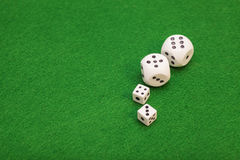 Dices on a green felt table Stock Image