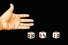 3 dices with hand. On black background Stock Photography