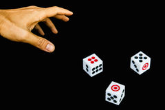 3 dices in hand. 3 dices with hand on black background Stock Photography