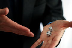 Dices in hand. Business man showing dices on his hand stock image