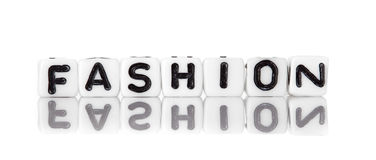 Dices with letters forming word: fashion Stock Image