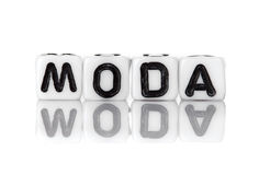 Dices with letters forming word: moda Stock Photos