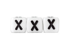 Dices with letters forming word: xxx Royalty Free Stock Photography