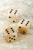 the dices on marble stone table Royalty Free Stock Photos