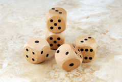 the dices on marble stone table Stock Images