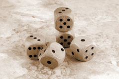 The dices on marble stone table Royalty Free Stock Image