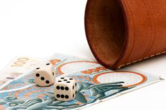 Dices and money. Two dices and some danish money on a white background Stock Image