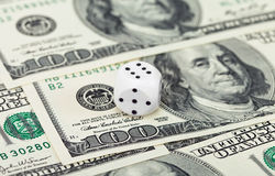 Dices on money background Royalty Free Stock Photography