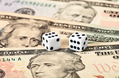 Dices on money background Royalty Free Stock Photo