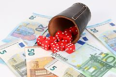Dices money and a cup in the studio stock photos