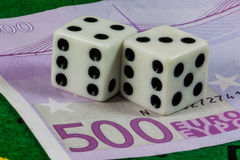 Dices over five hundreed euros banknote Royalty Free Stock Image