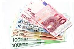 dices pieniądze Zdjęcie Stock