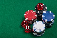 Dices and poker chips from above on green poker table royalty free stock images