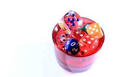 Dices in a red cup Royalty Free Stock Photo