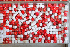 Dices. Red and white plastic dice pendants Stock Photo
