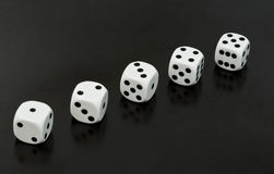 Dices row Stock Image