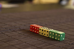 Dices in a Row. On the Table Stock Image