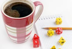 Dices for rpg, dnd or board games, notebook, pencil and a mug of coffee. Leisure time Royalty Free Stock Image