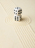 Dices on sand in rock garden Royalty Free Stock Image