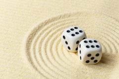 Dices on sand surface - abstract art composition Royalty Free Stock Photos