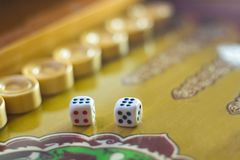Dices set.Play backgammon table game.Rolling dice in old board game.  royalty free stock image