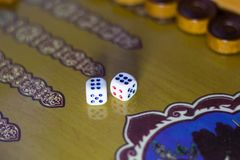 Dices set.Play backgammon table game.Rolling dice in old board game.  stock image