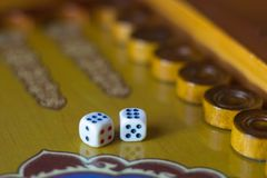 Dices set.Play backgammon table game.Rolling dice in old board game.  stock photo