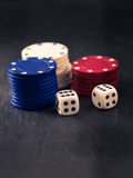 Dices and stacks of poker chips Stock Photos