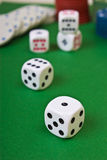 Dices on the table. Dices on the green table Royalty Free Stock Image