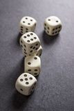 Dices on table. Close up photo of Six Dices on table, backlit Royalty Free Stock Photo