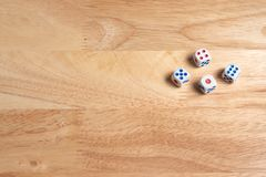 dices on wooden surface stock photography
