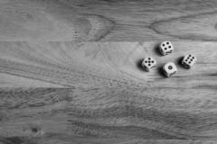 dices on wooden surface stock photos