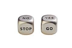 Dices with words Yes No Stop Go on white backgriund Royalty Free Stock Photos