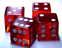 Dicey. Close up of Four Dodgy Dice Royalty Free Stock Photo
