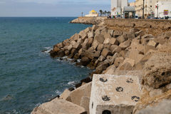Dicey in Cadiz. Some clever artwork on a concrete sea defence block in Cadiz, Spain Royalty Free Stock Photos