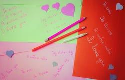 Dichiarazioni scritte a mano di amore Immagine Stock