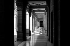 Dichotomy. Photo of a secluded corridor where light and shadow create the captured contrast stock image