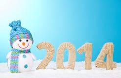 Dichtbijgelegen sneeuwman en cijfers 2014 Royalty-vrije Stock Foto's
