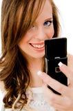 Dichte mening van mobiele vrouwenholding stock foto