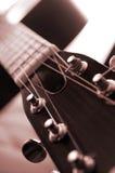 Dichte omhooggaand van de gitaar Stock Afbeelding